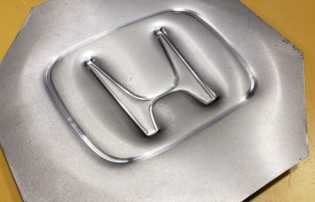 Incrementally formed Honda logo