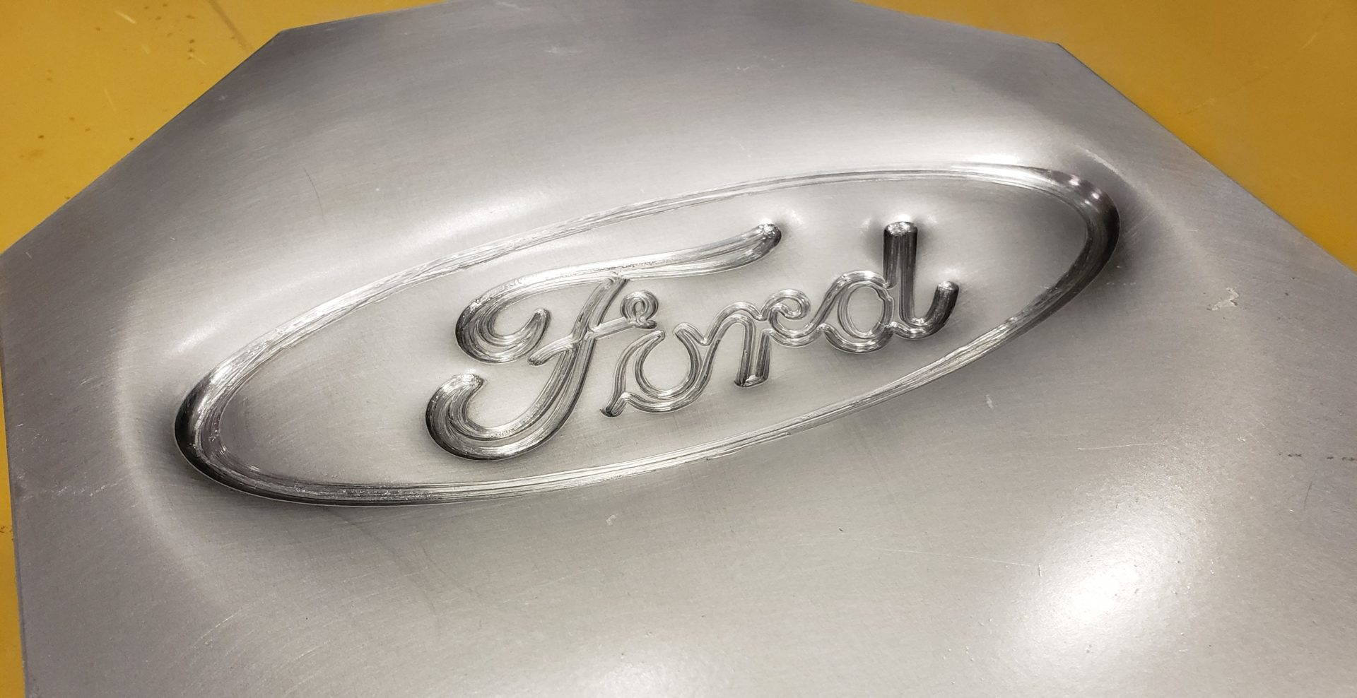 Incrementally formed Ford logo