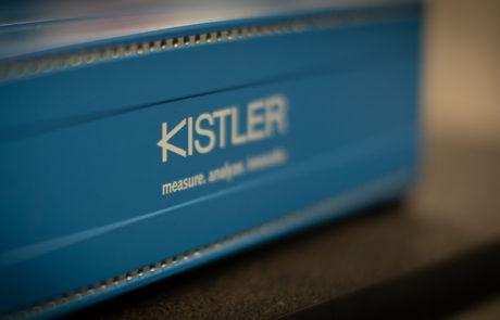 Close up view of the Kistler logo